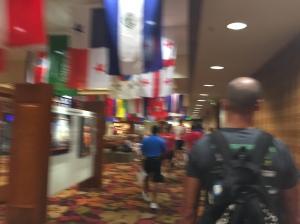 Walking through the King Kamehameha Hotel to the Body Marking tent