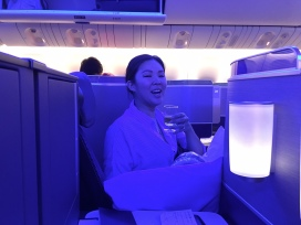 Michelle, enjoying her pre-flight sparkling wine